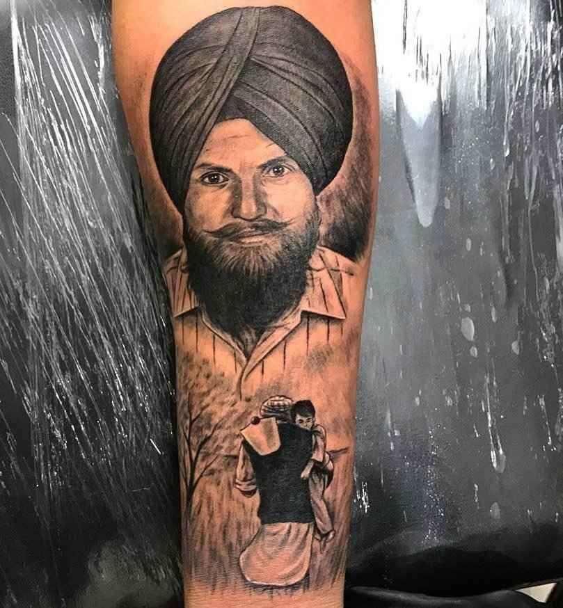 Father tattoo on Karan Aujla Arm